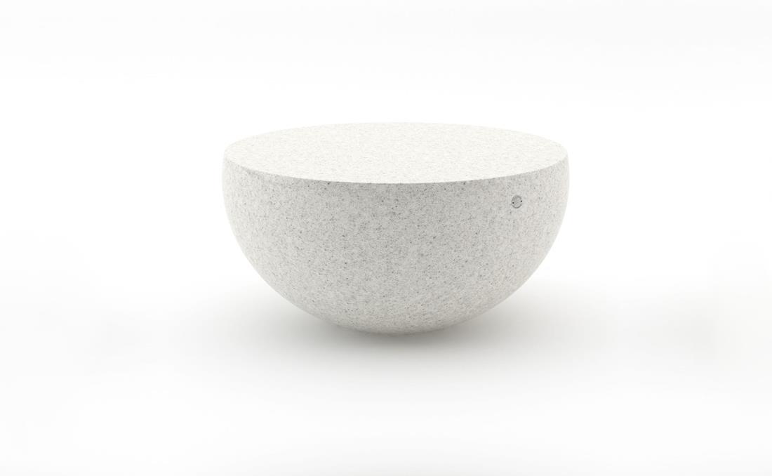Mesa en hormigón con forma semiesférica blanca.